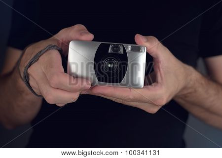 Man Taking Picture With Vintage Film Camera