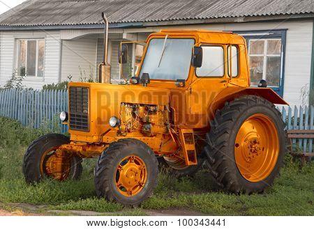 Farm tractor near the village house