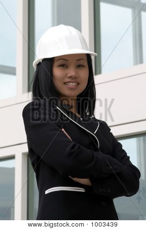 Female Asian Engineer With Arms Folded