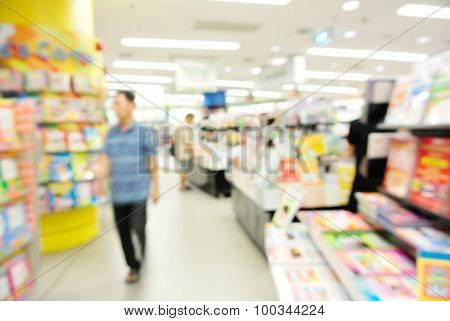 Blur Image Of People Reading And Buy A Book