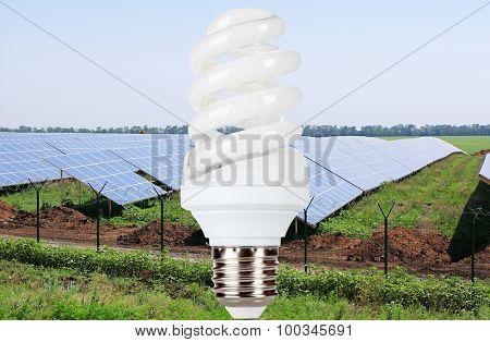 Light bulb on solar panels background