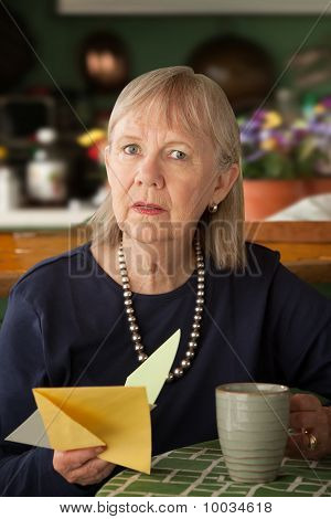 Senior Woman With Sympathy Card
