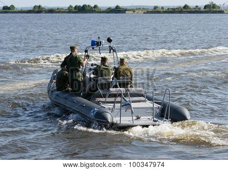 Russia, St. Petersburg, July 15, 2015. Military Navy Training. Navy Paratroopers. Boat Leaves Traini