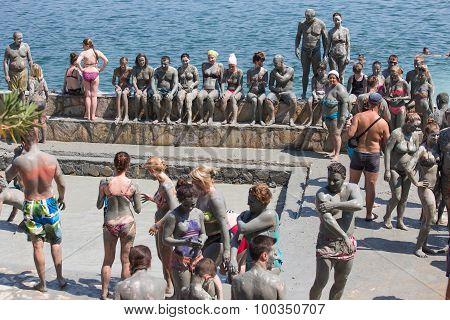 People In Grey Mud Bath. Dalyan, Turkey