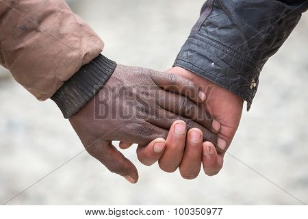 Pairs Of Men Hands On The Street In India