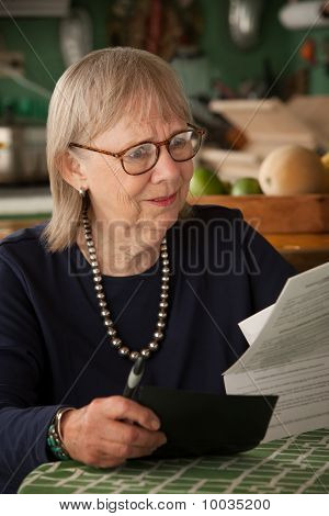 Senior Woman With Many Bills