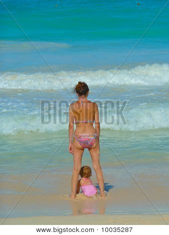Women With Baby Beside Her Legs