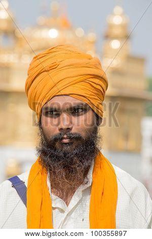 Portrait Sikh Man In Golden Temple In Amritsar, Punjab, India.