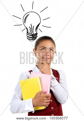 Beautiful little girl in school uniform with idea bulb above the head isolated on white