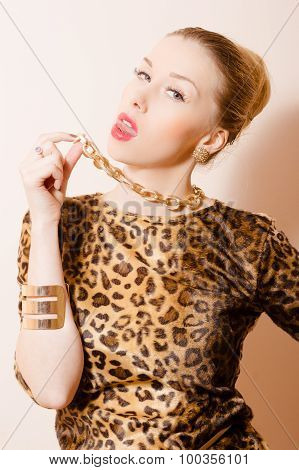 Seductive young provocative girl in leopard print showing her tongue
