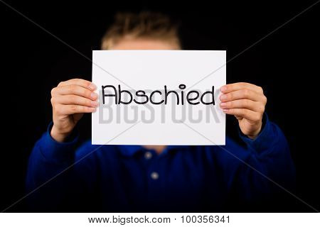 Child Holding Sign With German Word Abschied - Goodbye