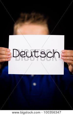 Child Holding Sign With German Word Deutsch - German In English