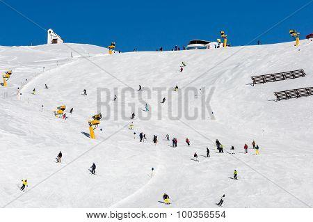 Skiers On Crowded Ski Run
