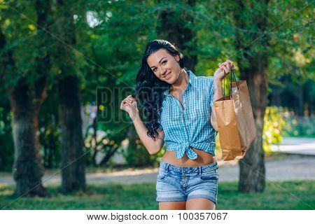 young trendy woman doing shopping  expresses its joy in  laughing