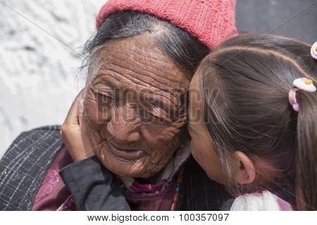 Tibetan Buddhist Old Women And Children In Hemis Monastery. Ladakh, North India