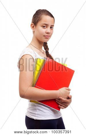Cute teen girl holding notebooks on white background