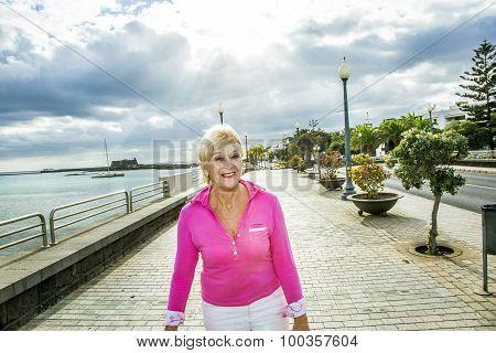 Portrait Of Attractive Tourist Walking Along The Promenade