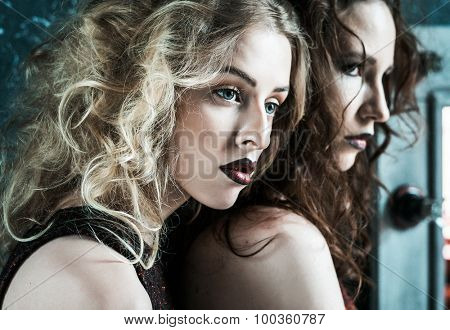 Vogue style photo of two fashion ladies, cold tones