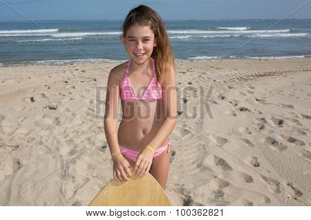 On The Beach Sweet Girl Have Fun With Skim Board