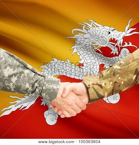 Men In Uniform Shaking Hands With Flag On Background - Bhutan