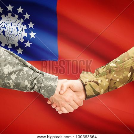 Men In Uniform Shaking Hands With Flag On Background - Burma