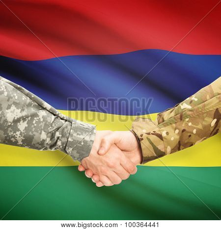 Men In Uniform Shaking Hands With Flag On Background - Mauritius