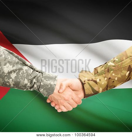 Men In Uniform Shaking Hands With Flag On Background - Palestine