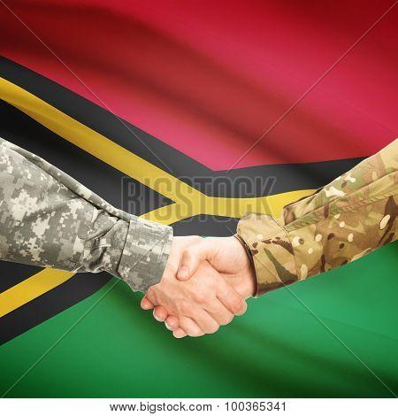 Men In Uniform Shaking Hands With Flag On Background - Vanuatu