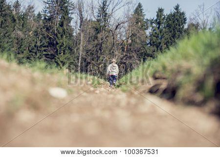 Small Boy Walking In Mountainous Countryside