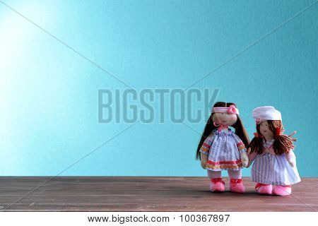 Dolls on blue background
