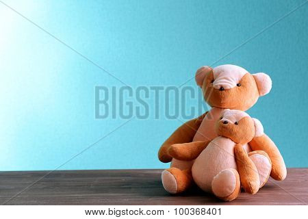 Teddy bears on blue background