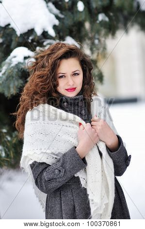 Winter Woman In Snow Looking Up At Copy Space Outside On Snowing Cold Winter Day. Portrait Multiethn