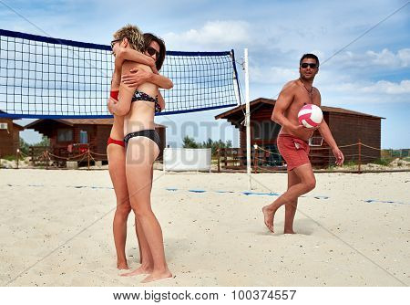 Volleyball Players Embracing After Match On The Beach