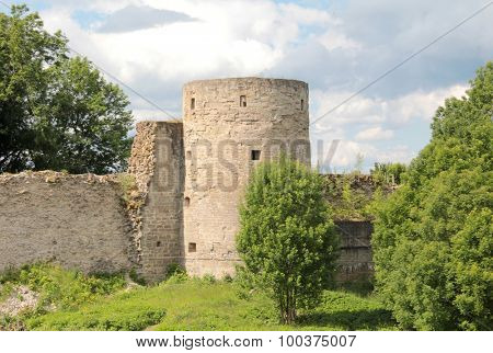 Ancient fortress of brick on sky background