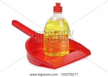 Red scrub and cleaning products on white background