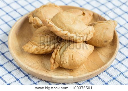 Thai Curry Puff On Wooden Dish
