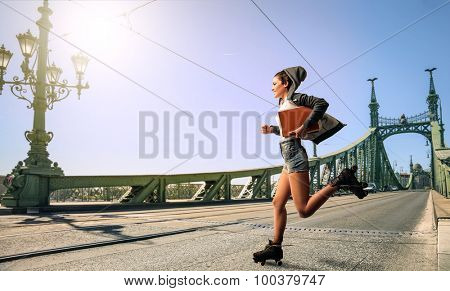 Woman roller skating to school