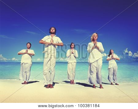 People performing yoga on the beach Peaceful Concept