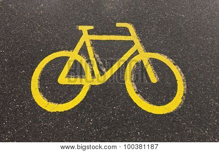 Bicycle road sign and on the asphalt