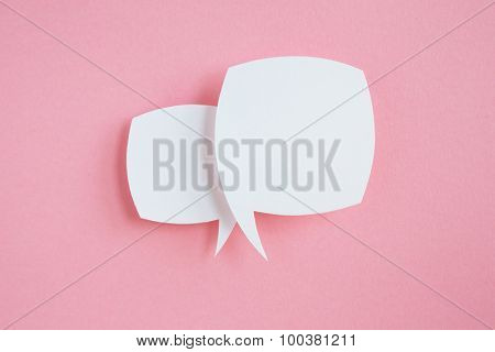 paper speech bubbles on pink background