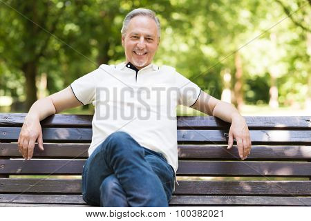 Portrait of a mature man relaxing in a park