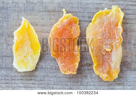 Piece of Dehydrated mango on wood table background