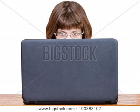 Girl With Spectacles Reads From Laptop Screen