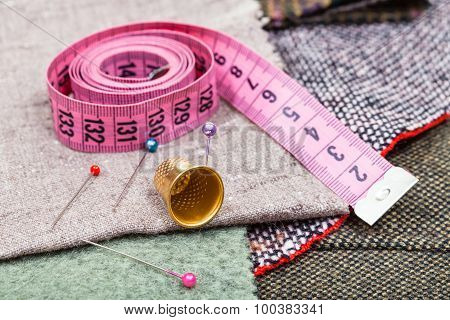 Pink Measure Tape, Pins, Thimble On Textile