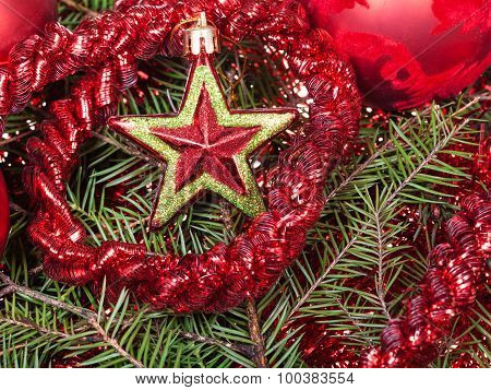 Red Star, Tinsel On Christmas Tree Background