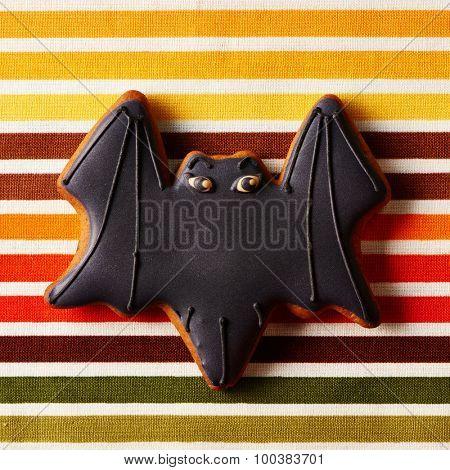 Halloween homemade gingerbread cookie over tablecloth