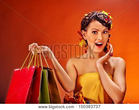 Girl with  autumn hairstyle and shopping bag.
