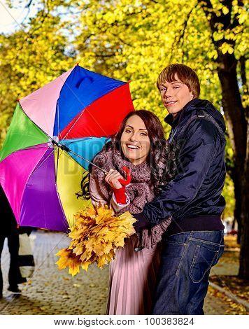 Couple holding umbrella  autumn outdoor.