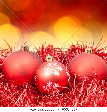 Xmas Red Balls On Blurred Red Yellow Background