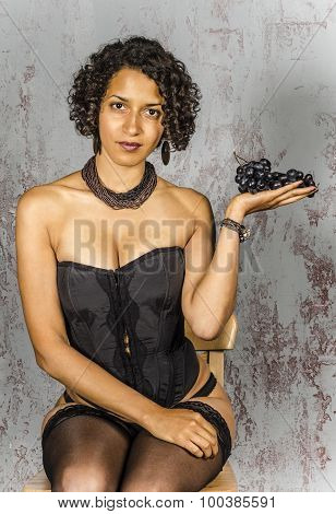 Beautiful mulatto girl with a  fruitand pantyhose with a basket of fruit